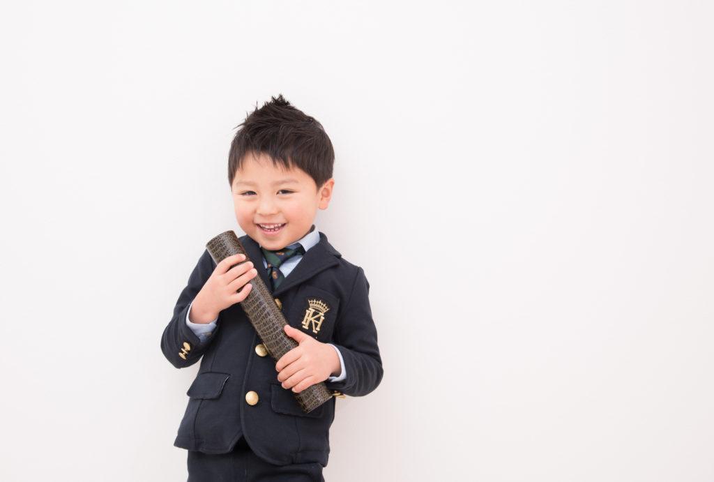 A boy Grab a Certification box