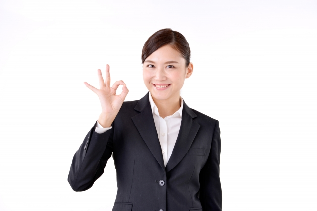 Young lady in suits with OK sign