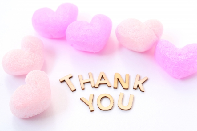 The sign of Thank you and Pink Hearts