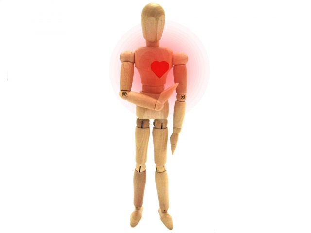 wood man with red heart
