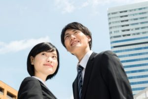 Man and Woman are standing under the blue sky