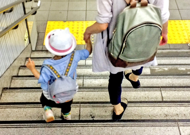 kid and mother in a station