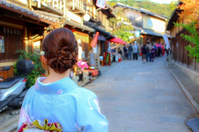 kimoon woman walk through a town
